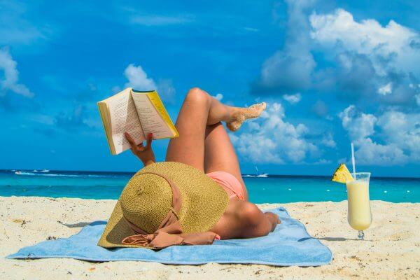 A Profitable Way To Multitask? Grab One Of These Money-Centric Beach Reads While You're Grabbing Some Rays