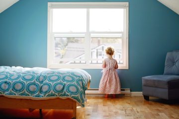 girl looking out window colorful