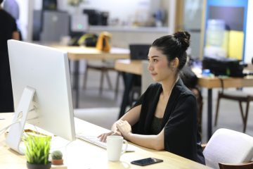 Woman working in an open office