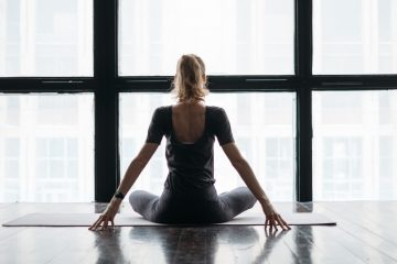 woman yoga window